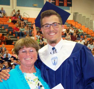 2015 Town of Orange Scholarship winner Connor Fenwick (R) with OCEF Board Member Martha Roby